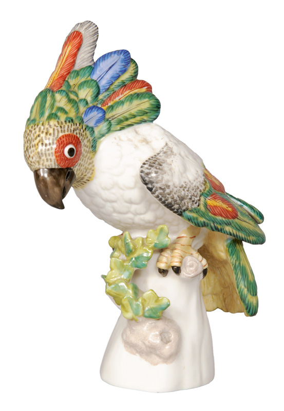 "A small figurine ""Cockatoo"" on branch base"