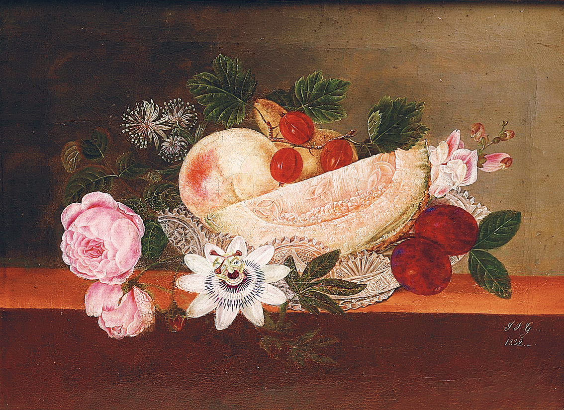 Fruits and flowers in a crystal-bowl on a board
