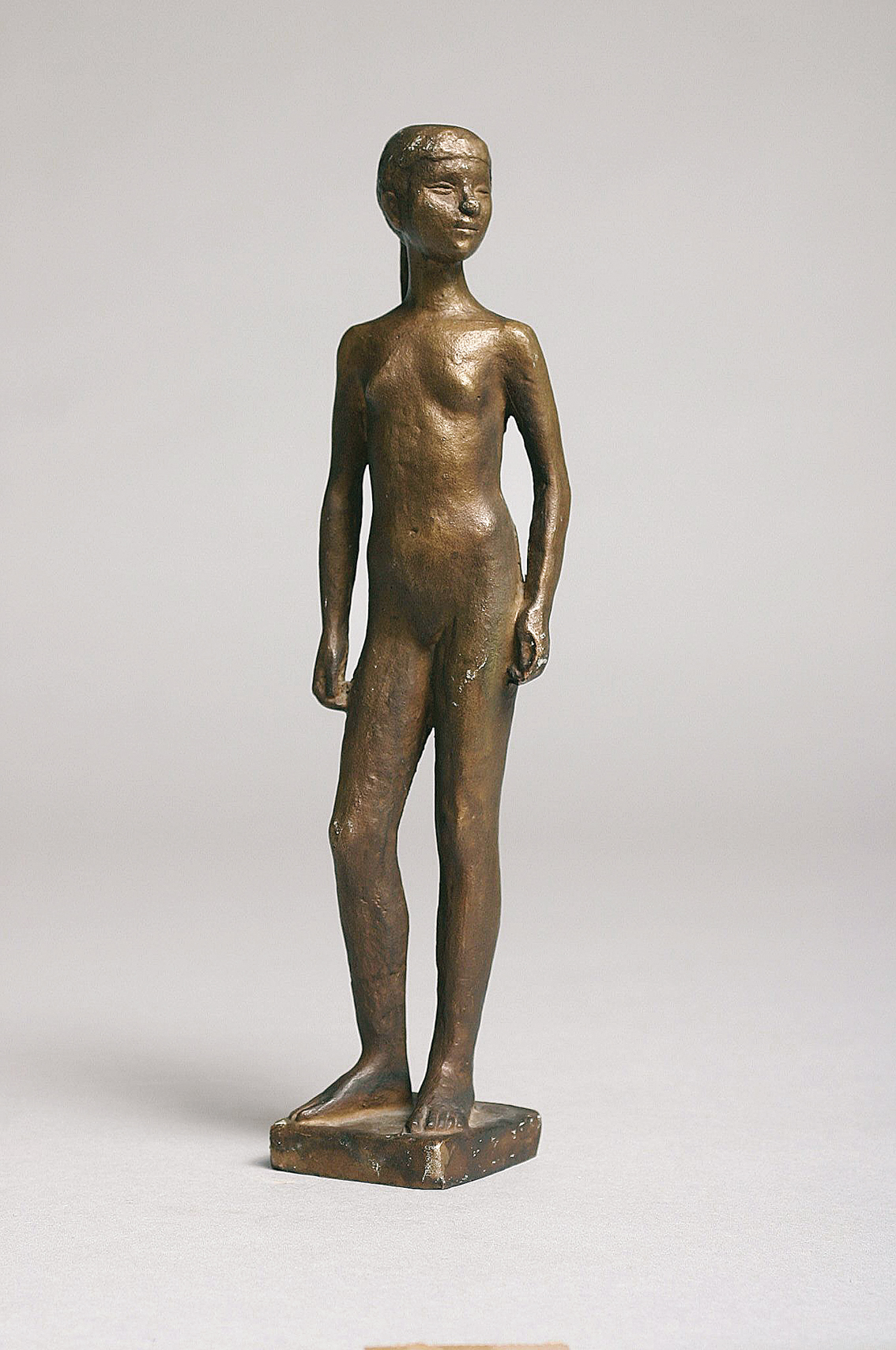A small modern bronze figure 'Standing female nude'