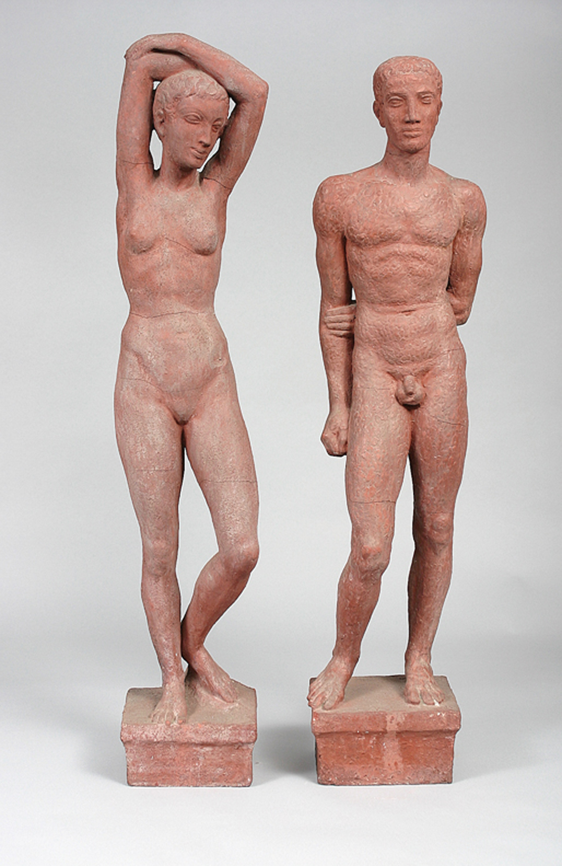 A pair of expressive figures 'female and male nude figures, standing'