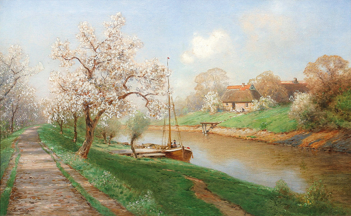 A river landscape with trees in blossom