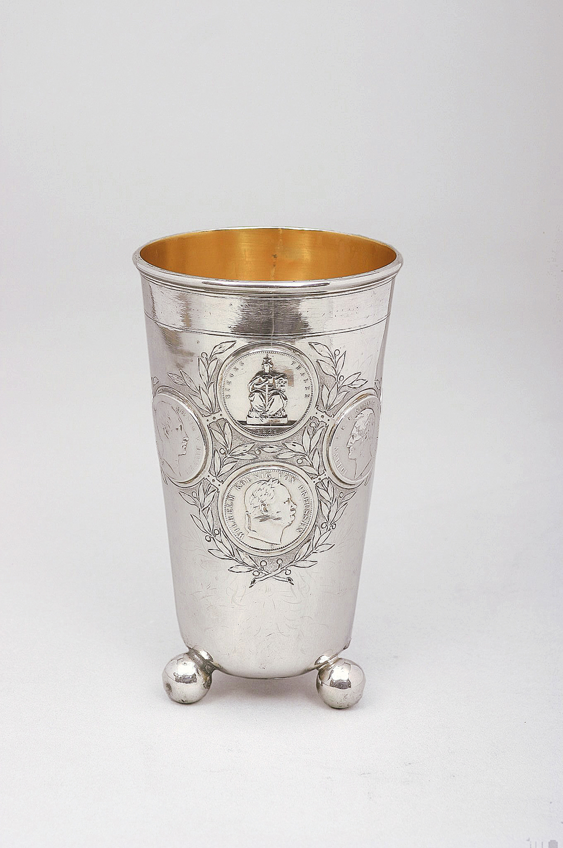 A Berlin cup with coins