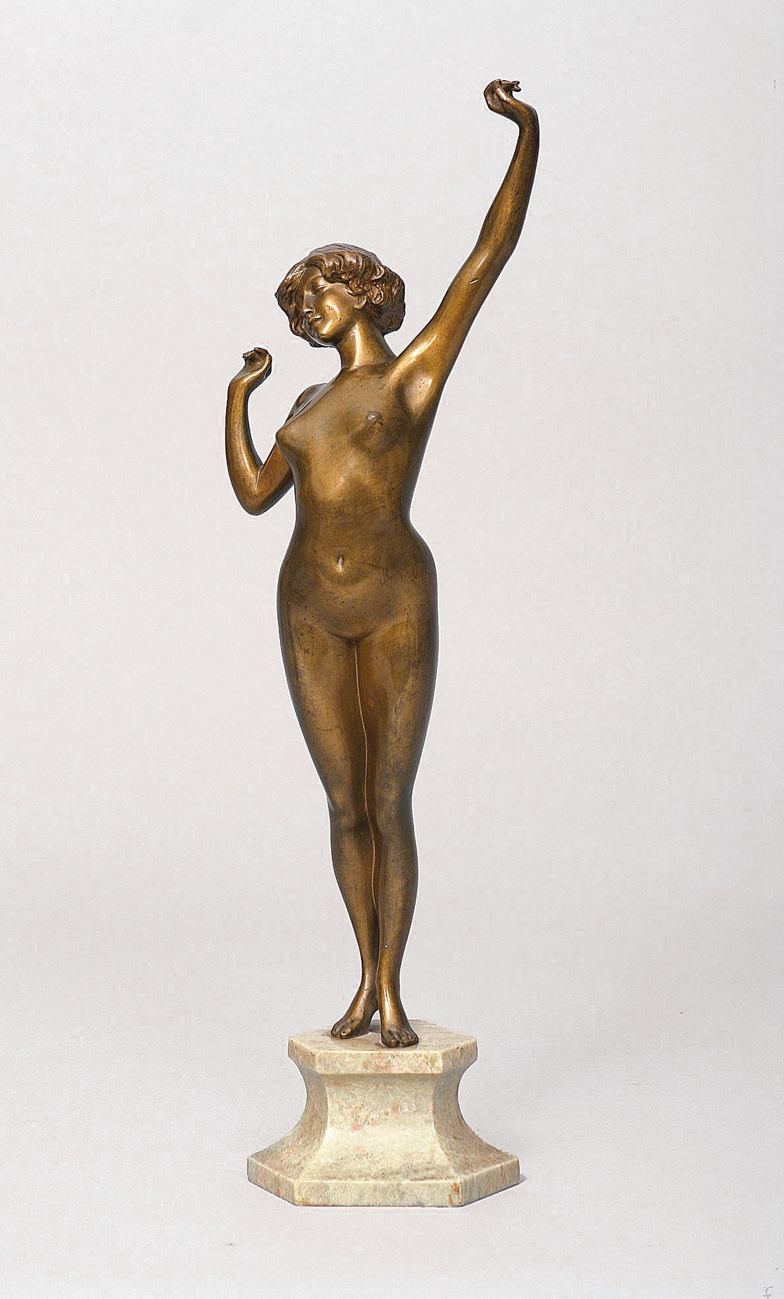 A small bronze figure 'female nude'