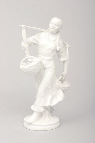 A figure of a Korean woman in white porcelain