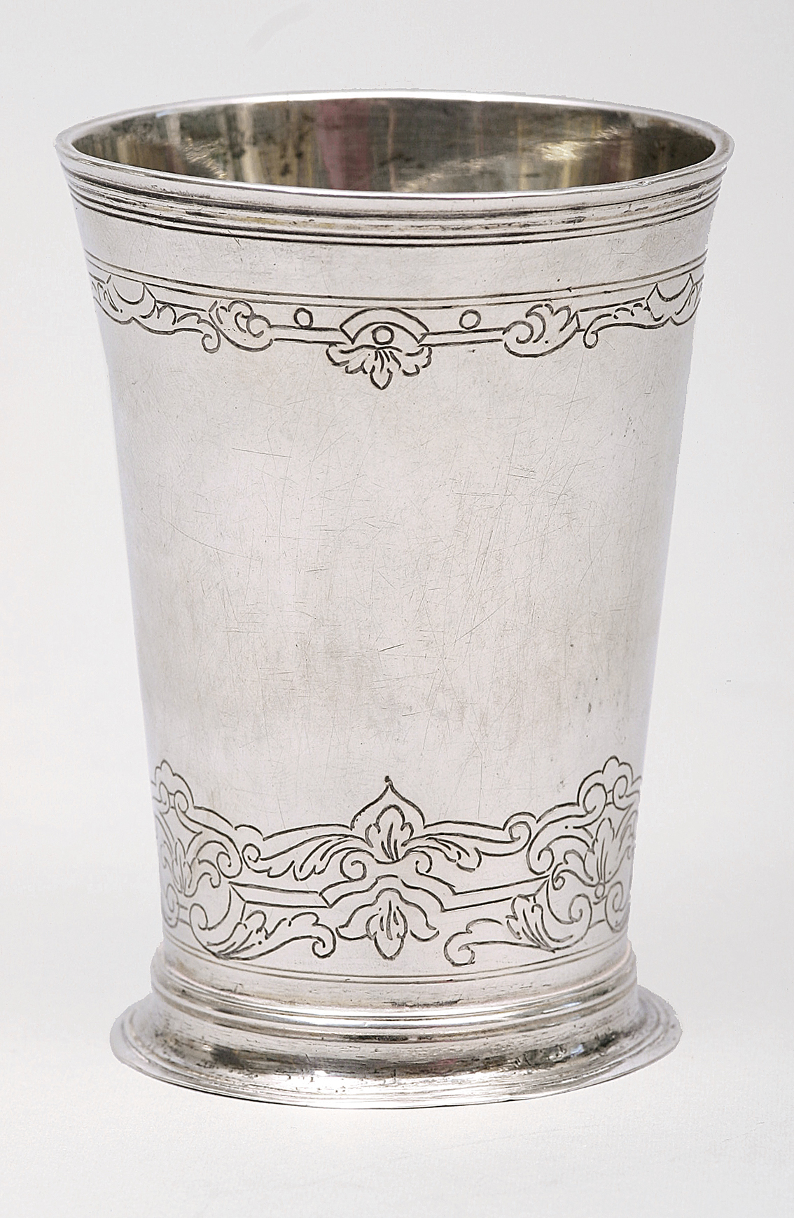 A small 'baroque' cup with fine engravings