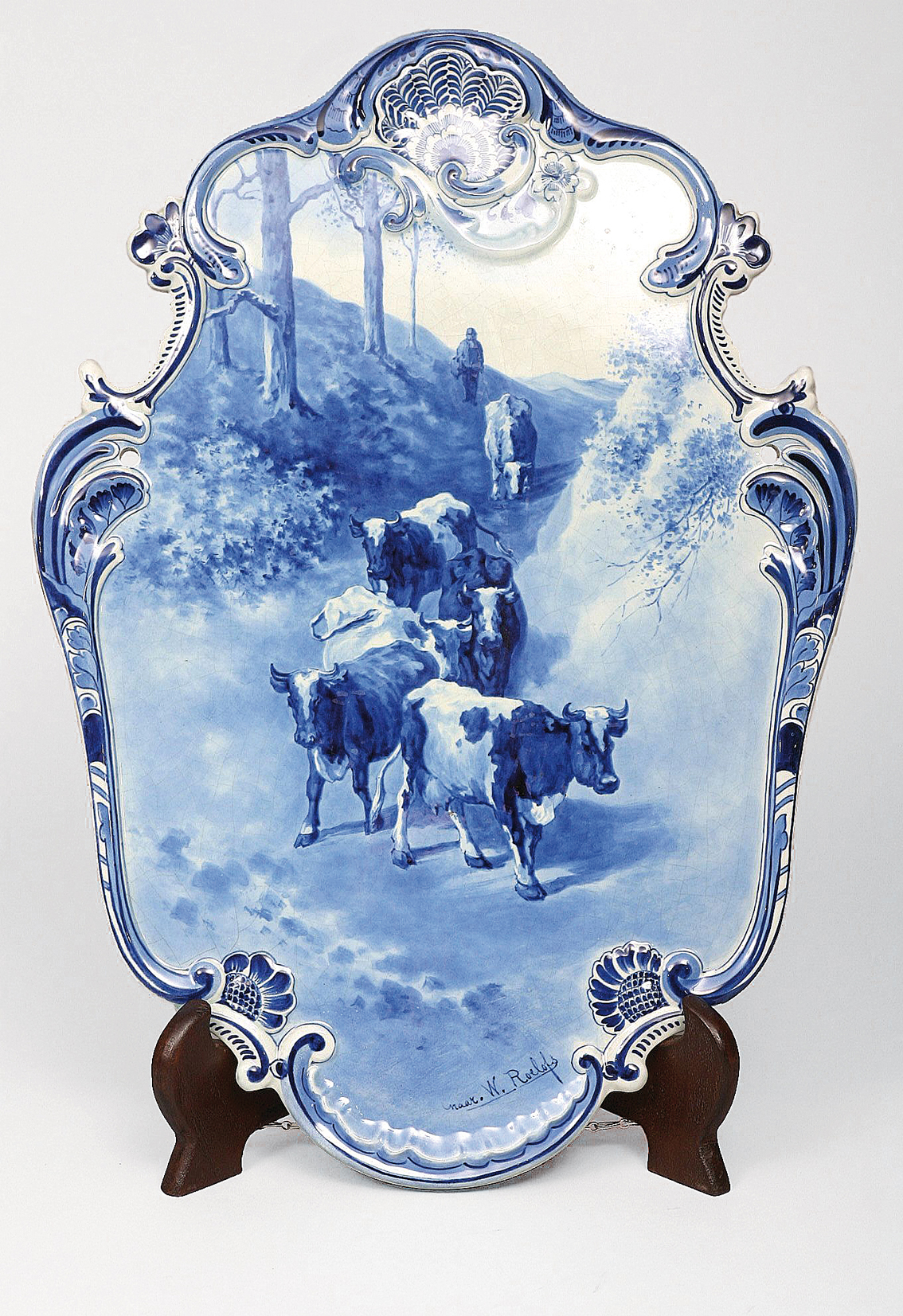 A large plate 'peasant with cows' in u'glaze blue