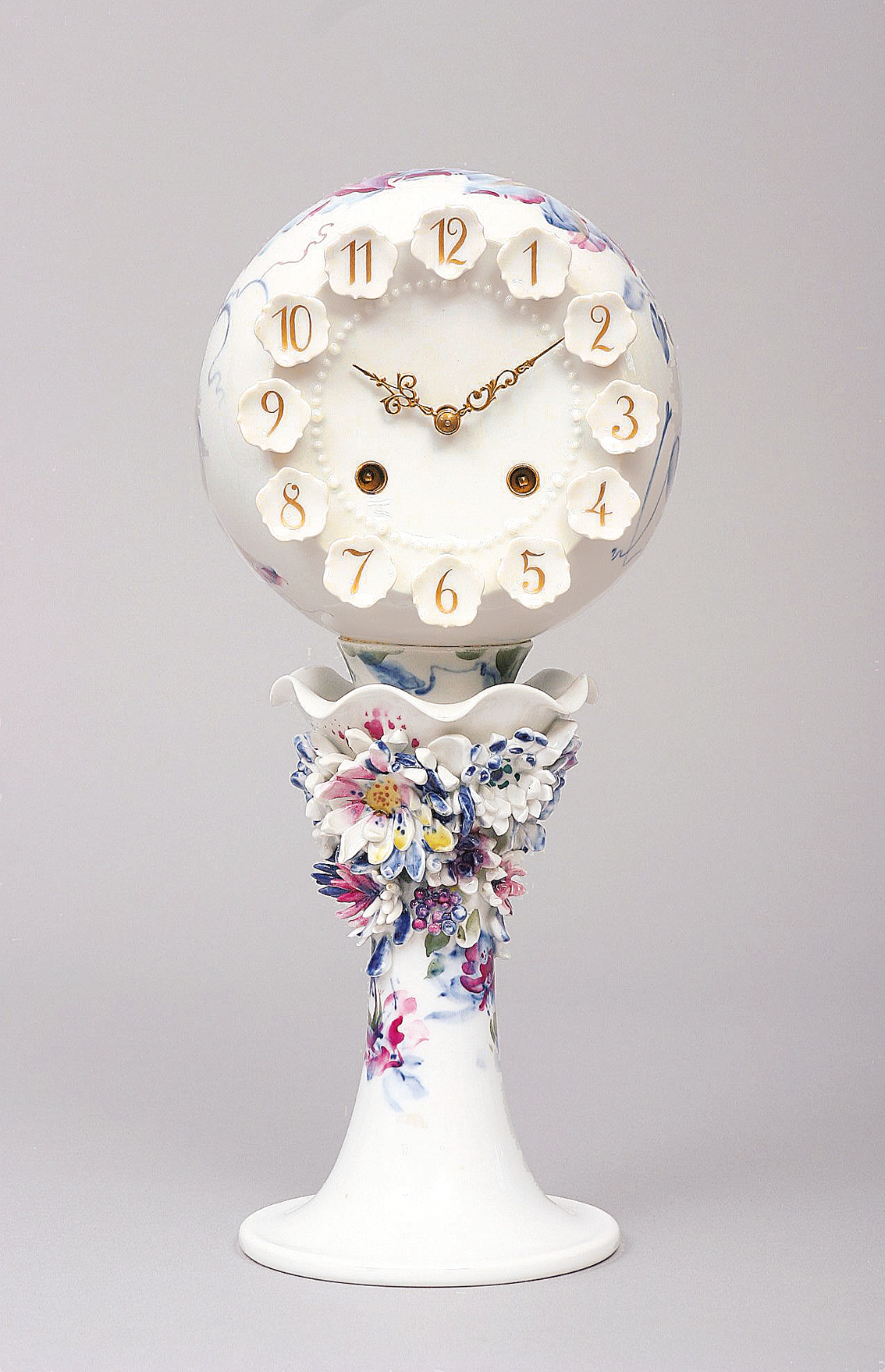 A rare modern model of a clock with floral decoration