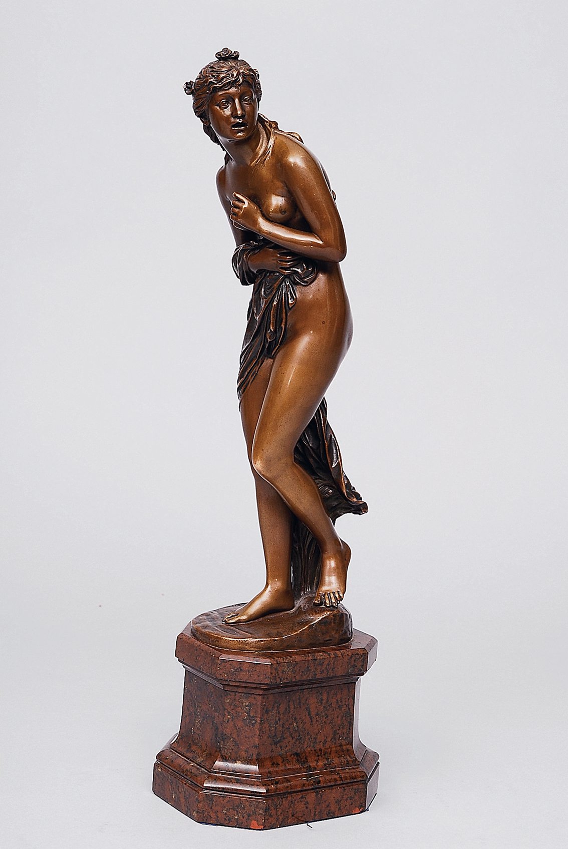 A bronze figure 'A nymphe caught by surprise during bathing'