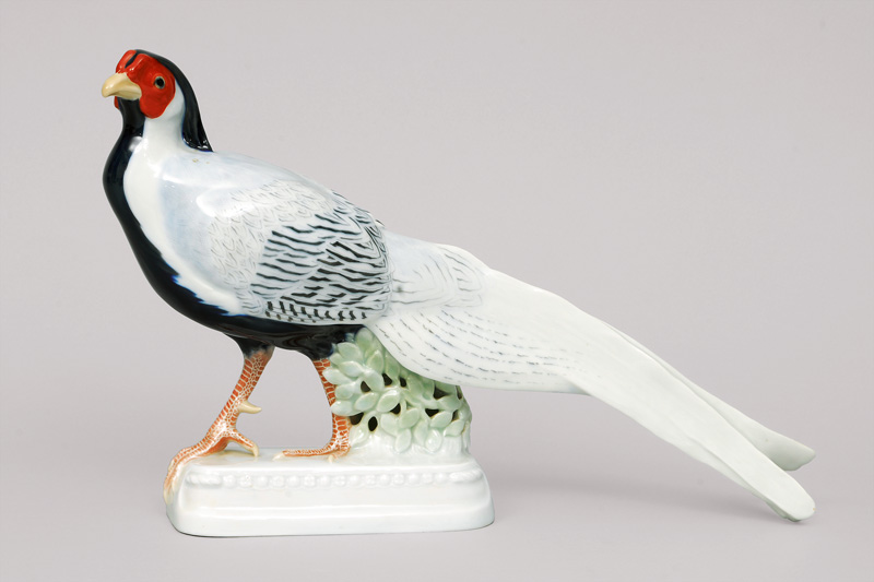 An expressive bird figurine 'marching pheasant' on moulded base