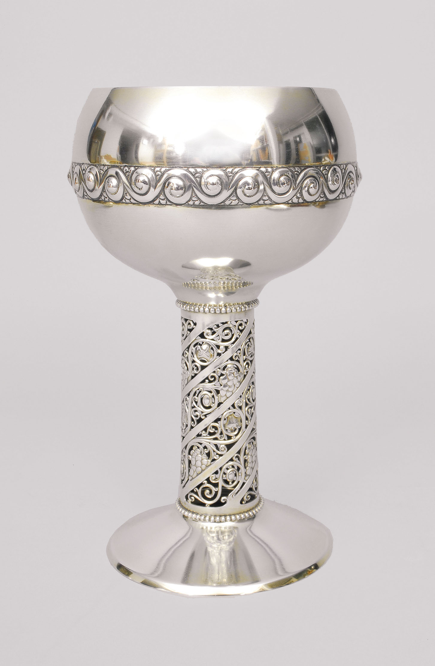 An Art-Nouveau goblet with ornaments of grapes