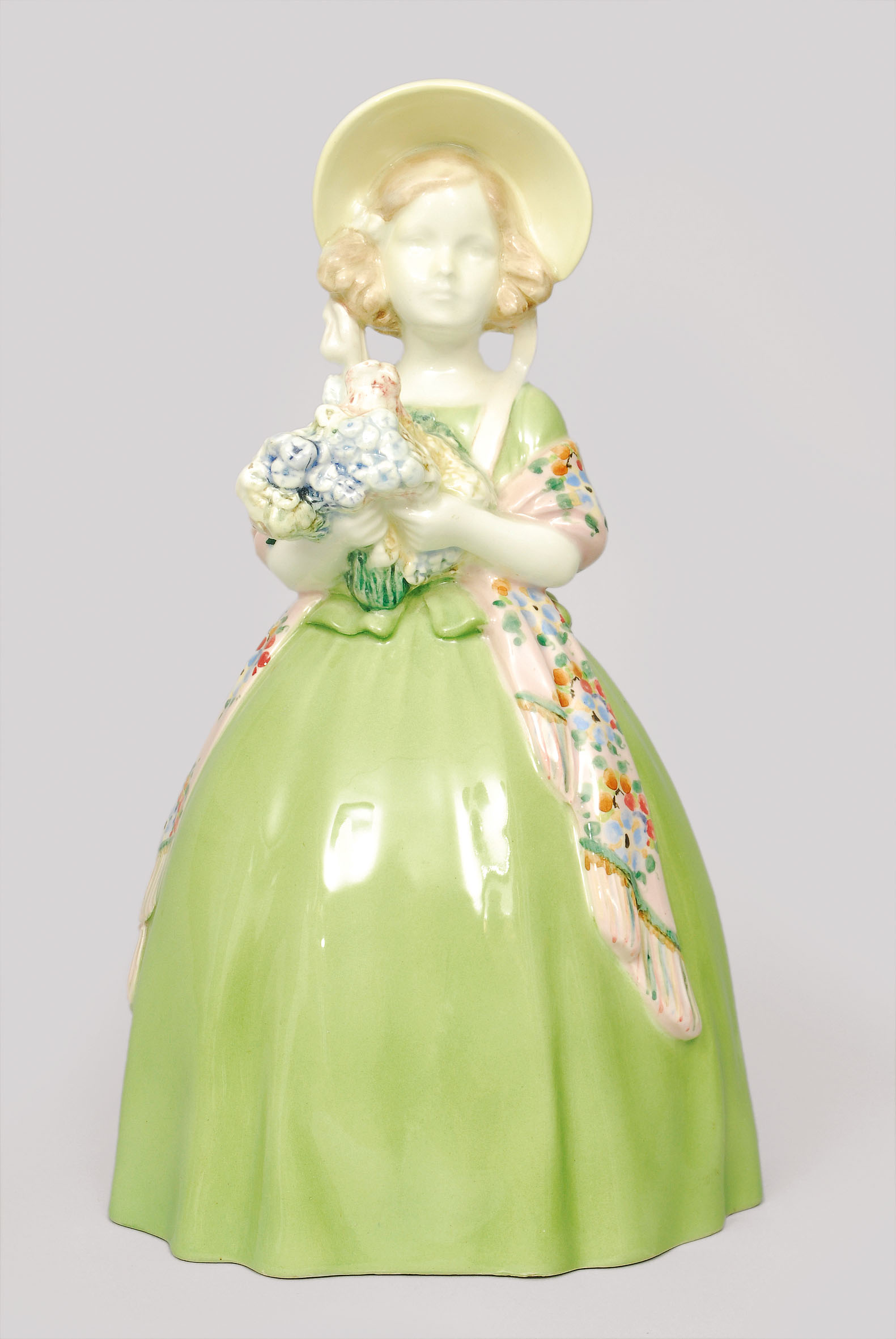 A figurine 'Biedermeier' girl with hat and bouquet