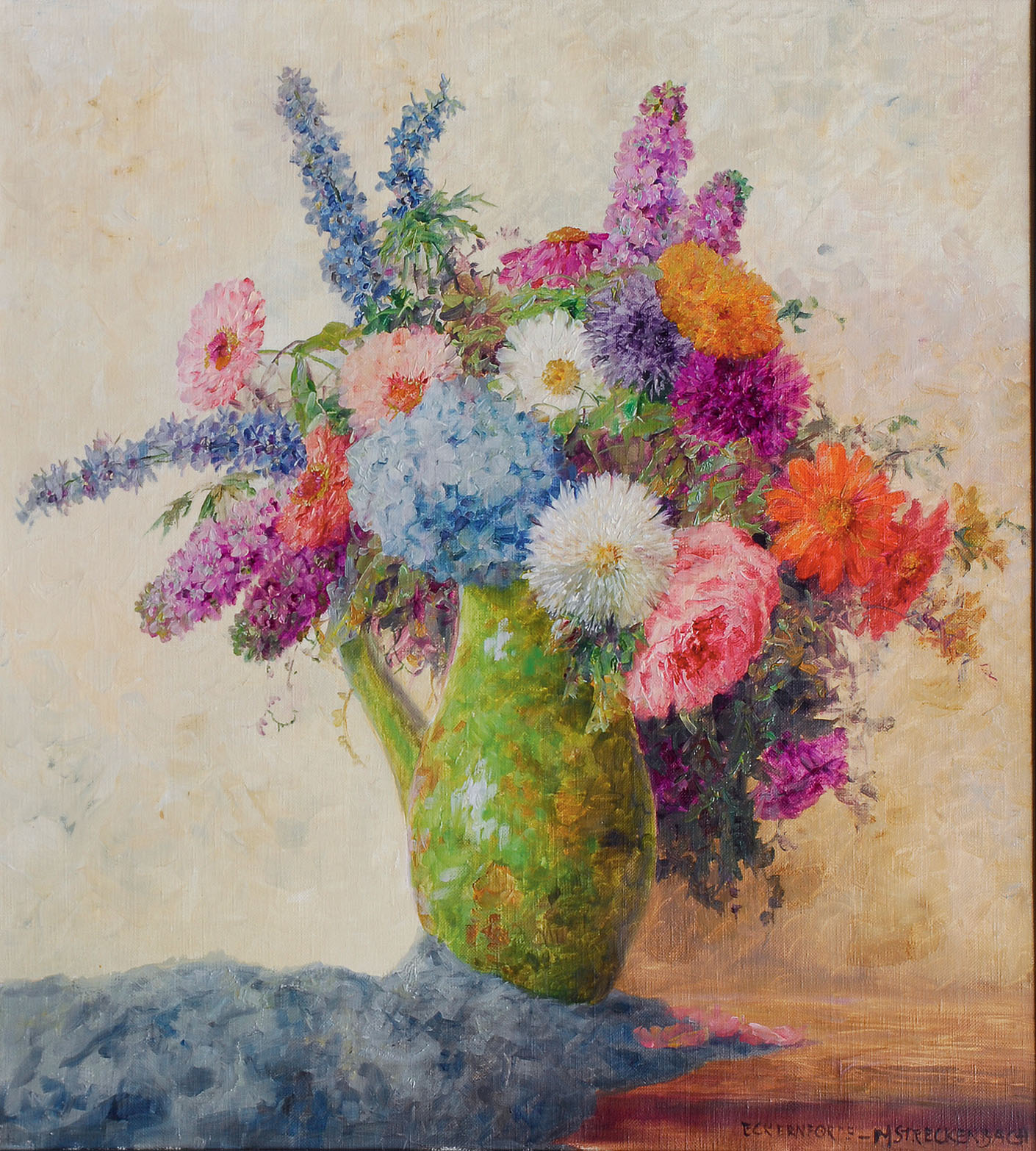 Bouquet of flowers in a green jug