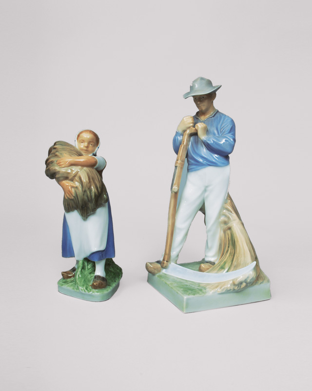 A pair of figurines 'farmer with scythe and girl with spikes'