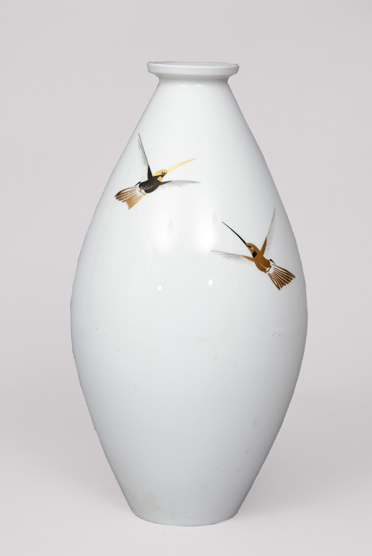 A big Art Deco vase with hummingbird decoration