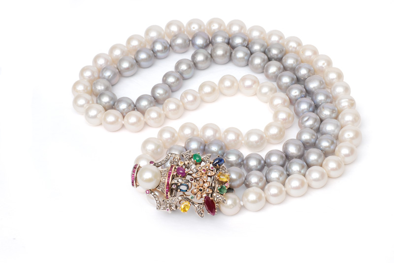 A pearl necklace with jewel-clasp