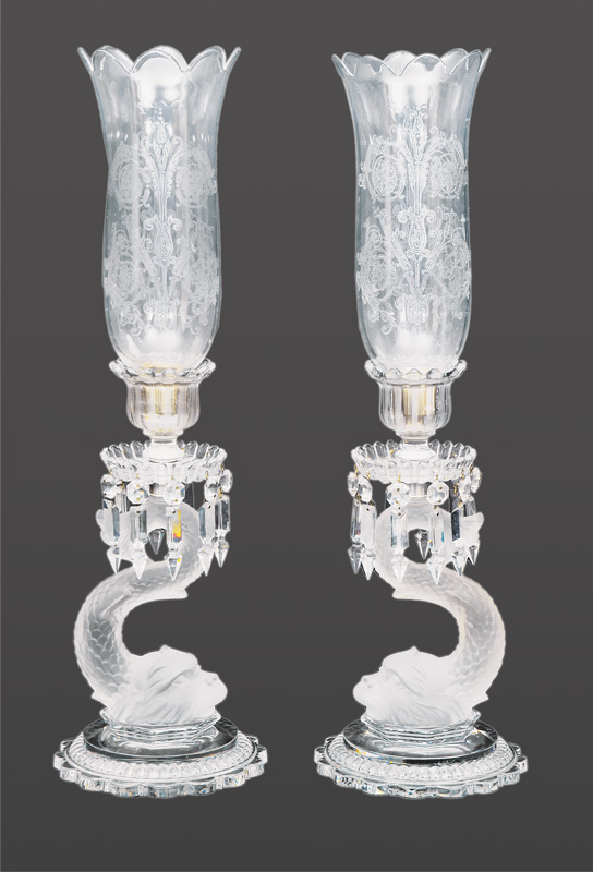 A pair of big Baccarat candel sticks with dolphin