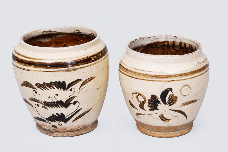A pair of early pithoi with stylised floral decoration