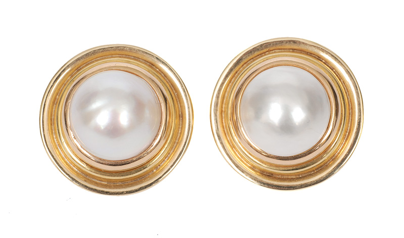 A pair of mabé pearl ear studs