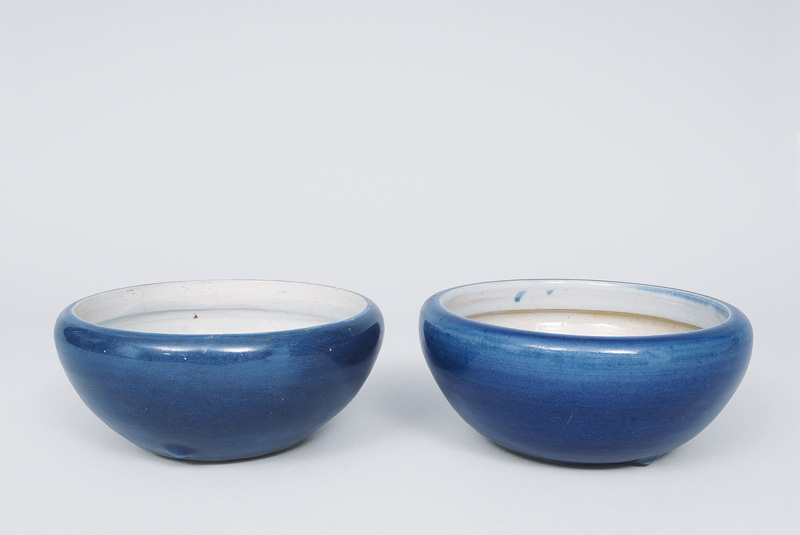 A pair of blue glazed bowls