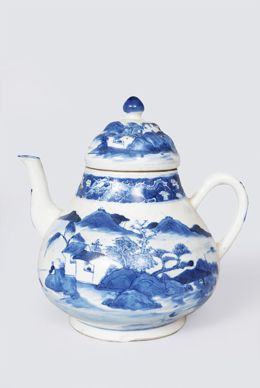 A teapot with landscape in blue