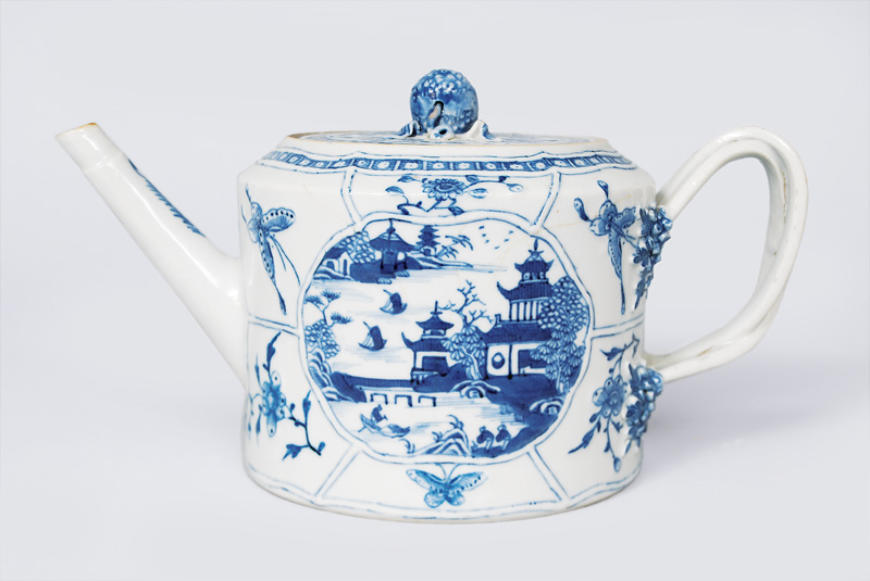 A teapot with landscape in blue painting