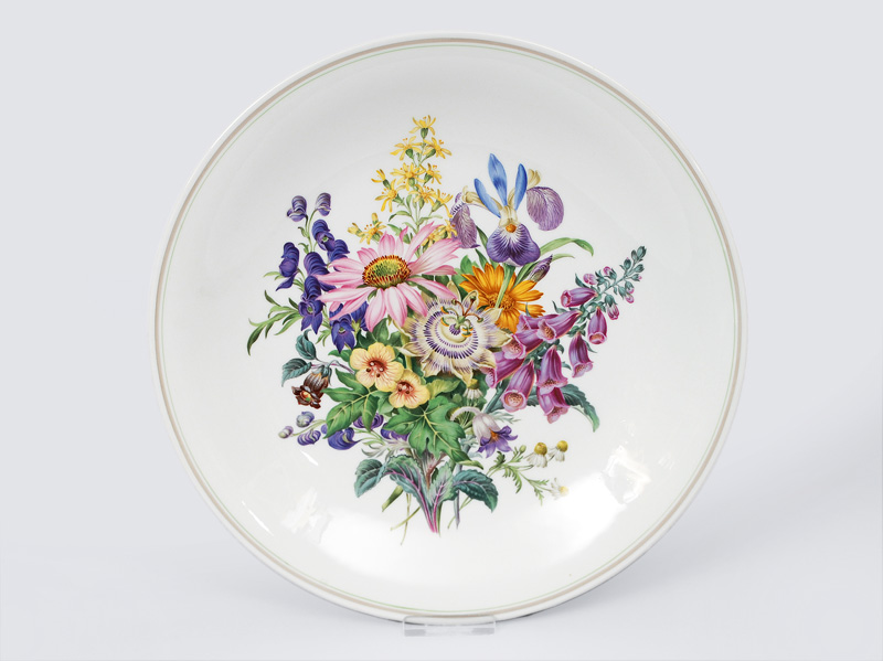 A big plate with detail painted flower bouquet