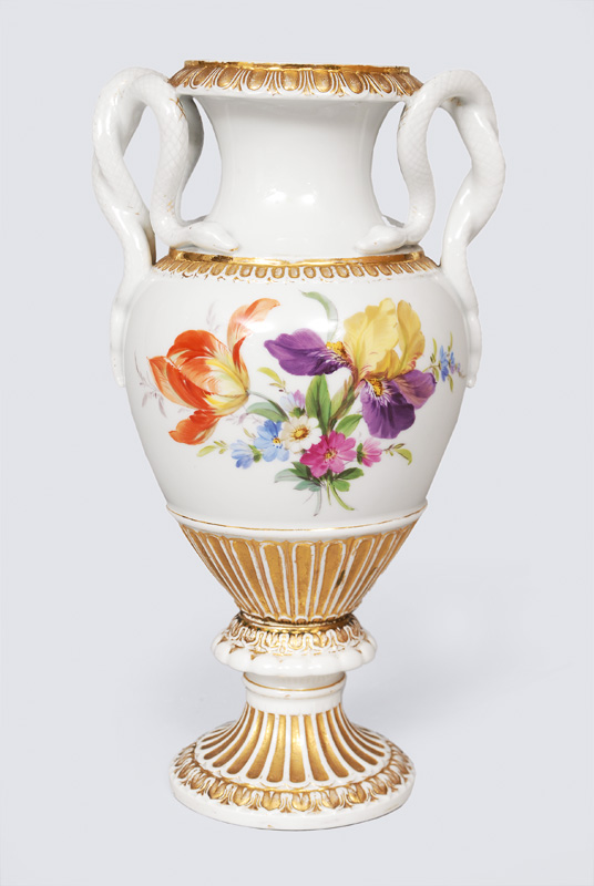 A snake handle vase with flower decoration