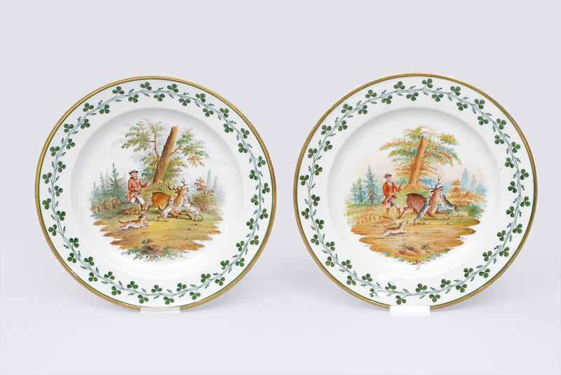 A pair of plates with a hunting scene