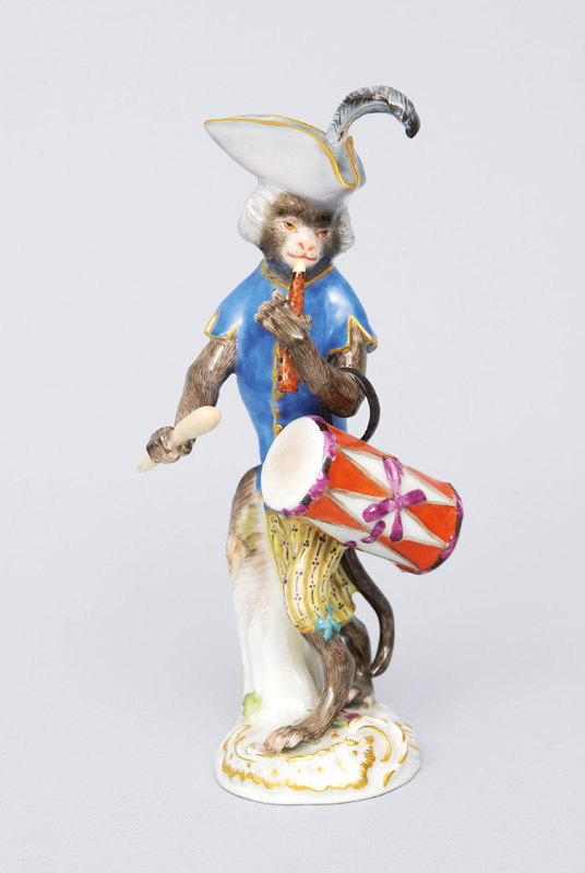 "A figurine ""drummer"" of serial ""music playing monkeys"""