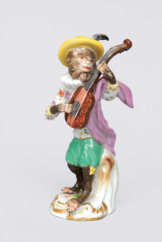 "A figurine ""guitar player"" of serial ""music playing monkeys"""