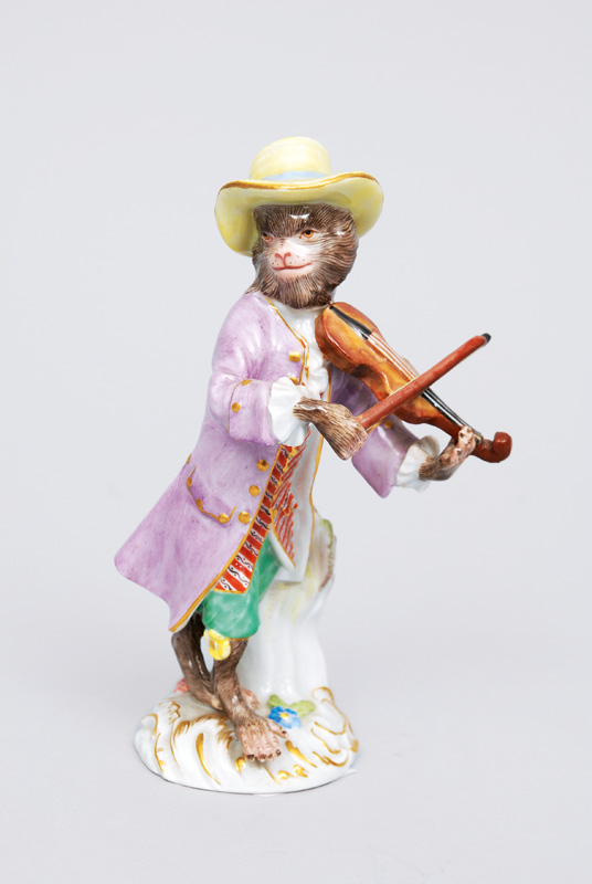 "A figurine ""violinist"" of serial ""music playing monkeys"""