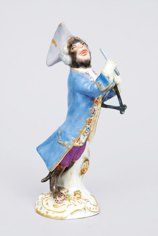 "A figurine ""triangle player"" of serial ""music playing monkeys"""