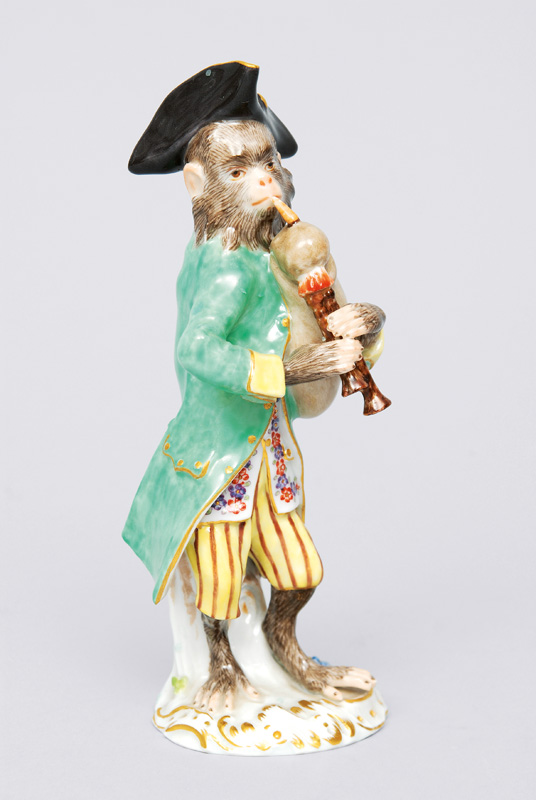 "A figurine ""bagpipe player"" of serial ""music playing monkeys"""