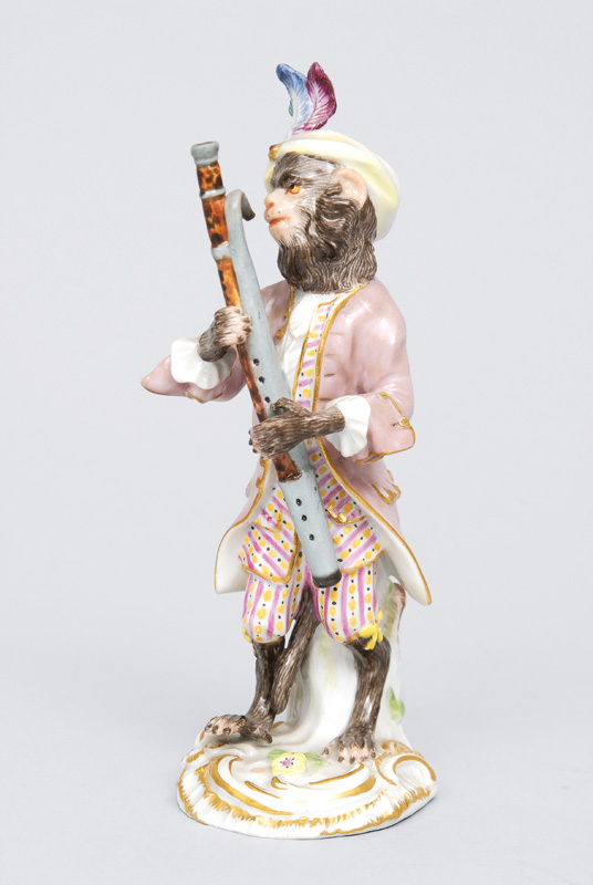 "A figurine ""basson player"" of serial ""music playing monkeys"""