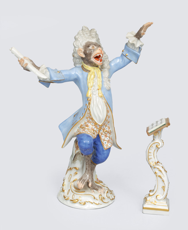 "A figurine ""chief conductor with music desk"" of ""music playing monkeys"""