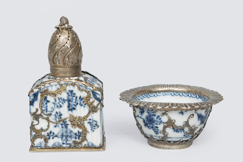 A spice shaker and tea bowl with blue painting and silver mounting