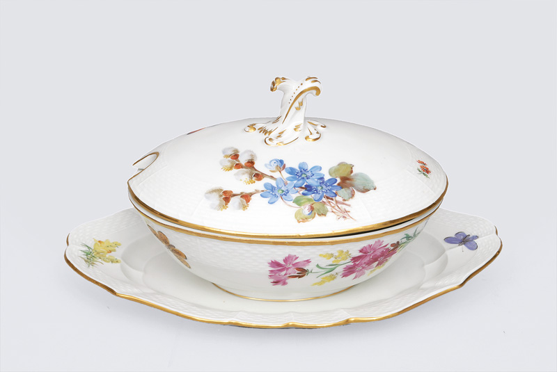 An oval tureen with bouquet and butterfly painting