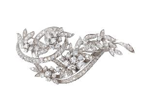 A flower shaped brooch with diamonds