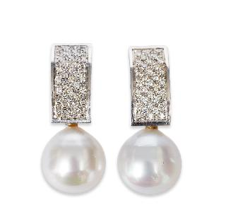 A pair of platinum earrings with southsea pearls and diamonds