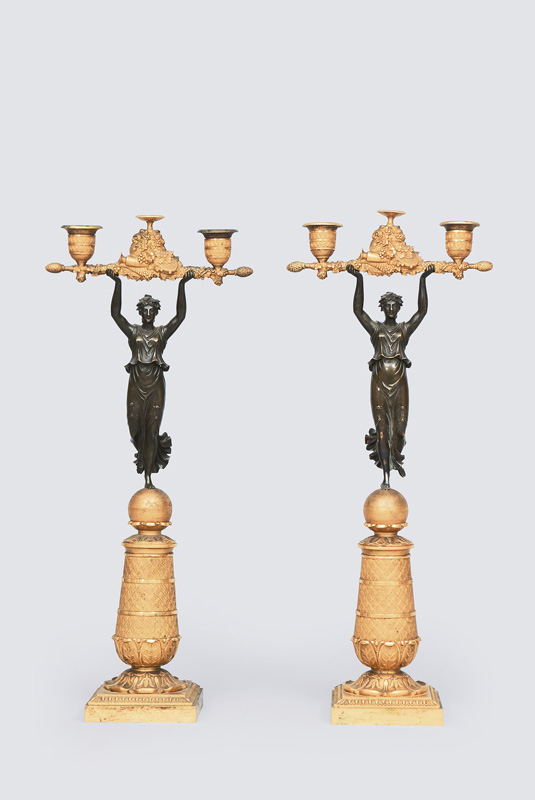 A pair of Empire candelabra with figurine of Victoria