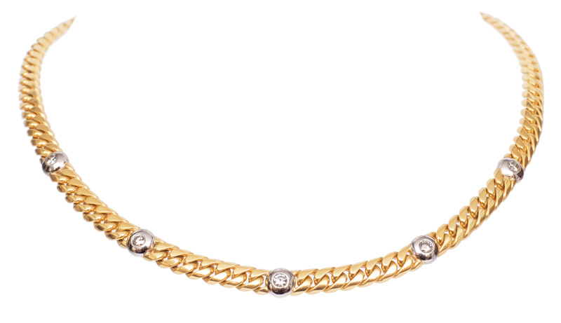 A golden necklace with diamonds