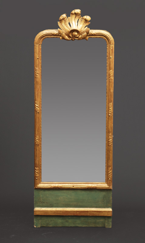 A Louis-Seize mirror with foliage ornaments
