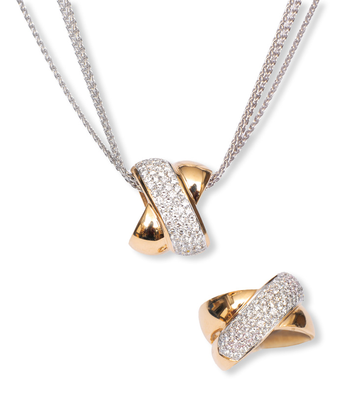 A diamond pendant with matching ring by jeweller Christ
