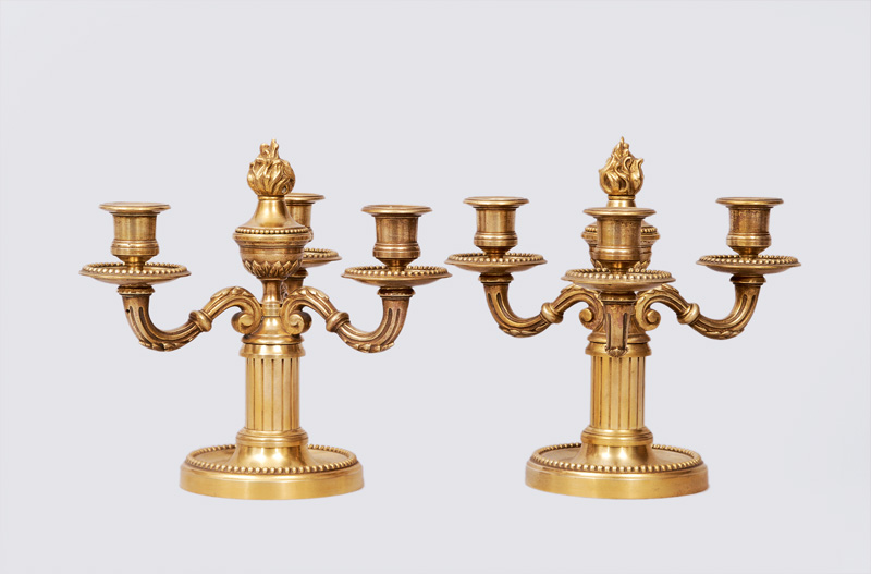 A pair of candlesticks with 3 lights