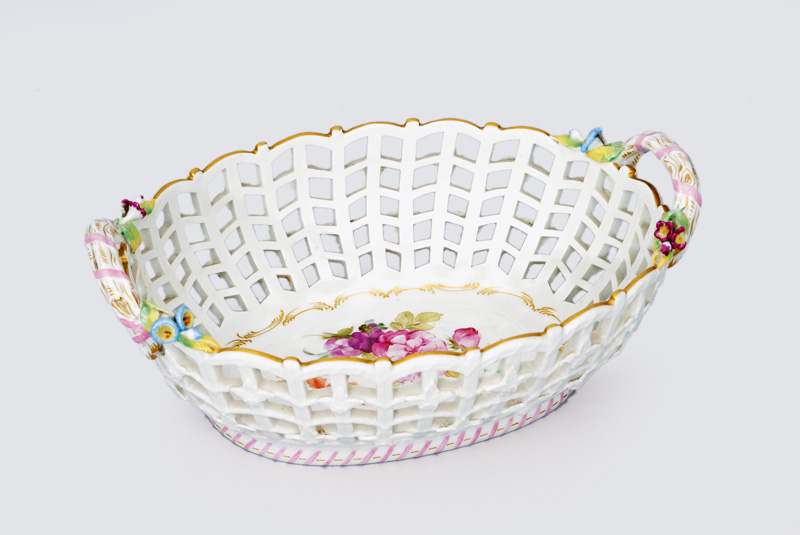 An oval open worked bowl with branch-shaped handles and blossoms