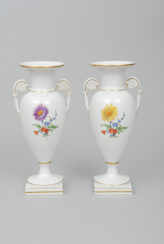 A pair of amphorae-shaped vases with flower painting and gilding