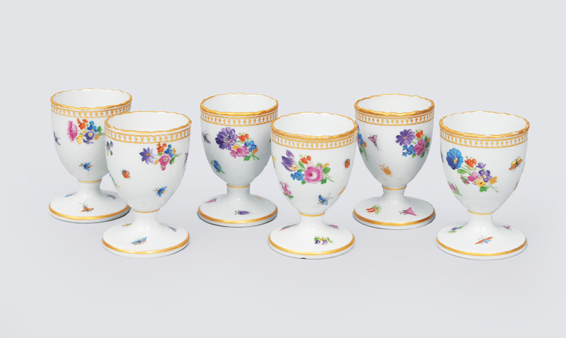 A set of 6 egg cups with flower paintings, insects and gilded rim