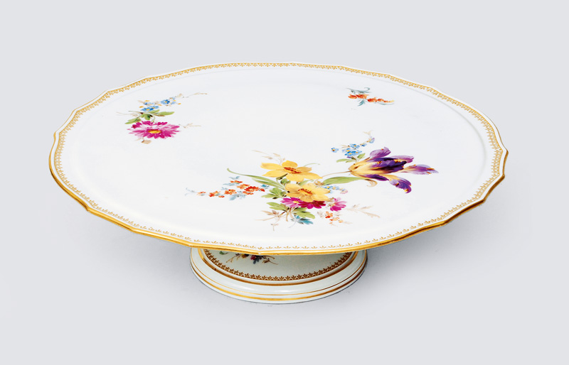 A huge footed cake plate with flower painting