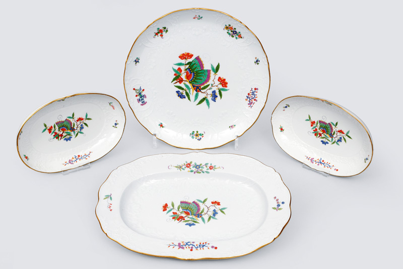A convolute of 4 different platters with Marseille relief and butterfly pattern