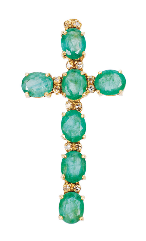 An emerald diamond cross pendant